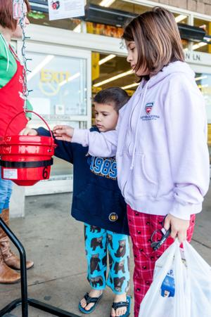 Lodi Living Editor Sara Jane Pohlman takes shift on red kettle for Salvation Army