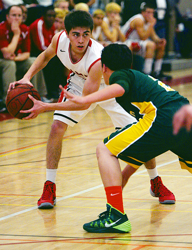 Boys basketball: Flames back in the hunt with win over Yellowjackets