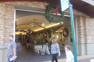 Lodi Shops Kickstart The Holiday Season: Shoppers view wreaths and holly decorations at Downtown Lodi shops on Saturday, Nov. 24, 2012. The holiday shopping season began with open houses at several stores.  - Photo by Sara Jane Pohlman/News-Sentinel