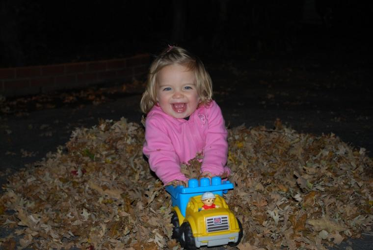 Playing with the fall leaves