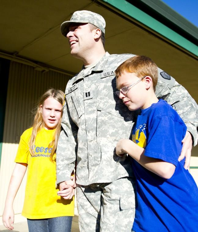Soldier surprises his kids at school while on leave for the holidays