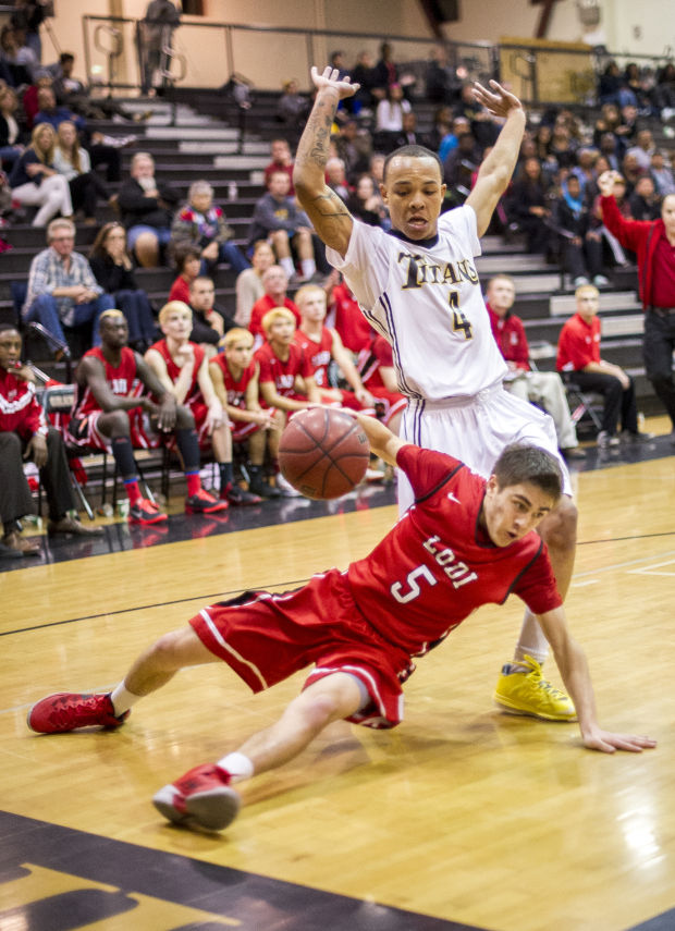 Boys basketball: Flames denied at buzzer, lose to Titans