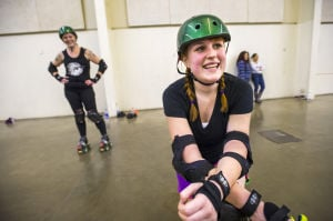 Reporter Skates After Her Derby Girl Dreams : News-Sentinel reporter Sara Jane Pohlman takes a knee, giving up the roller derby challenge after an hour of drills and falling at the San Joaquin County Fairgrounds on Thursday, Feb. 7, 2013.  - Photo by Dan Evans/News-Sentinel