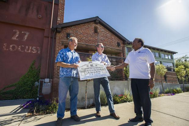 Olde Ice House owners receive award for restoring, repurposing crumbling Downtown building