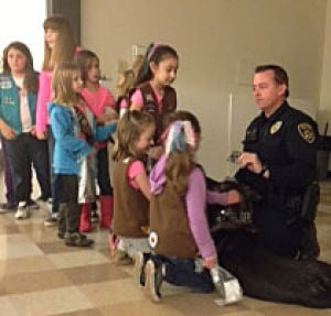 Memorial Services Set For Fallen Galt Police Officer Kevin Tonn: Officer Kevin Tonn met with area Girl Scouts last weekend to discuss how the girls could stay safe when selling cookies door-to-door. After the presentation, the girls were allowed to visit with Officer Tonn and his dog, Yaro.  - Photo by Maria Cuevas/Courtesy Photograph