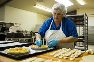 Spaans head baker Patty Staggs enjoys baking treats for customers