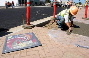 Crews install mosaics as first phase of Lodi Avenue project winds down; businesses see decline in customers