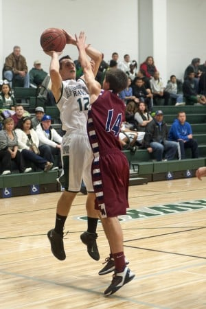 Boys basketball: Hawks soar in second half