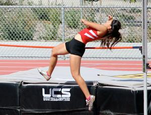 Girls track and field: Flames rout Titans