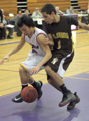 Boys basketball: Tigers use big third quarter to roll past Delta Kings