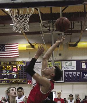 Boys basketball: Flames end skid with win over Tigers