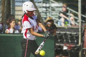 Softball: Late eruption lifts Flames