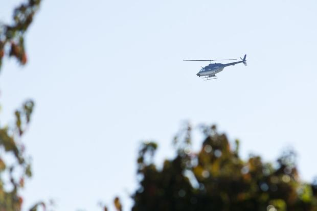 Low-flying helicopter checks for gas leaks