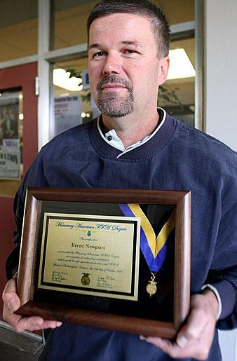 FFA adviser Brent Newport receives honorary degree from national organization
