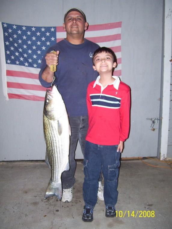 father and son catch a wopper