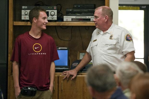 Teen gives awards to Clements firefighters, EMTs who saved his life