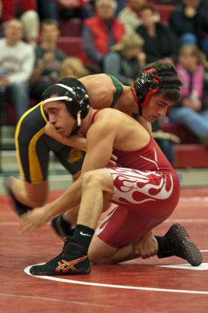 Wrestling: Flames rumble past Bulldogs