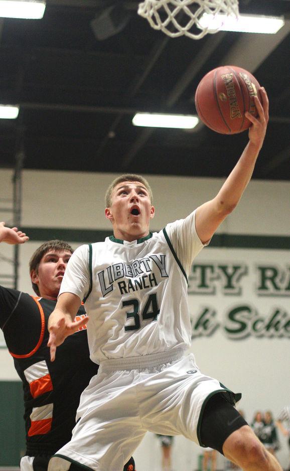 Boys basketball: Hawks hold off Cougars and make history