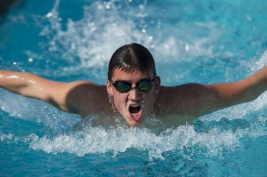 Swimming: Flames sweep rival Tigers