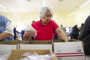 Lodi Support Our Troops members, volunteers pack 2,500 care packages