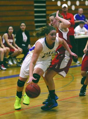 Girls basketball: Tigers stifle Flames