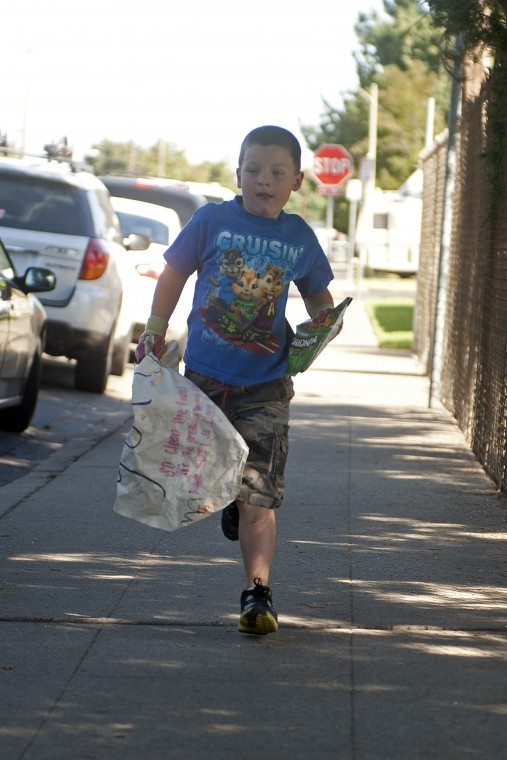 Lodis Roman Mangrich, 5, recognized for work as one man cleaning crew