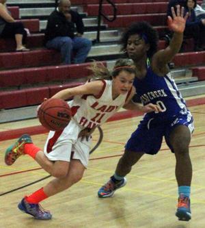 Girls basketball: Late rally falls short as Flames suffer first league setback