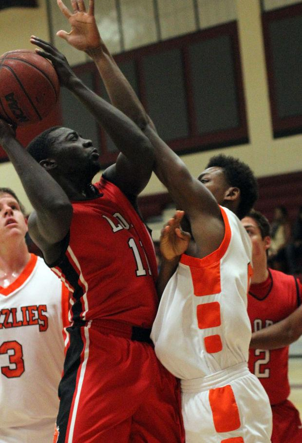 Boys basketball: Flames overmatched in loss to powerhouse Grizzlies