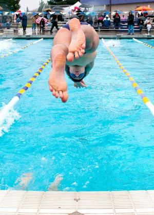 Tokay Tigers boys sink Lincoln Trojans at swim meet; Girls lose close one