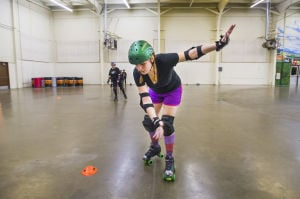 Reporter Skates After Her Derby Girl Dreams : News-Sentinel reporter Sara Jane Pohlman nearly falls while practicing stopping drills during the Port City Roller Girl's practice at the San Joaquin County Fairgrounds on Thursday, Feb. 7, 2013.  - Dan Evans/News-Sentinel