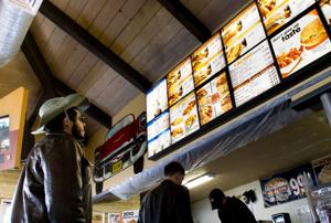 Fast food restaurants display nutritional values of food on menu boards
