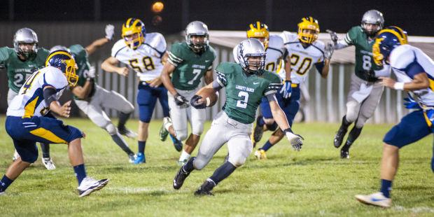 Football: Hawks survive late Jaguars rally