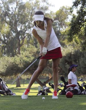 High school golf: Depth favors Flames over the Tigers
