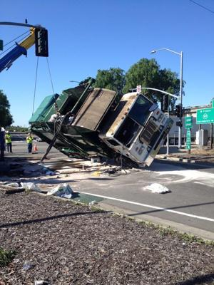 Truck rolls over on Kettleman Lane