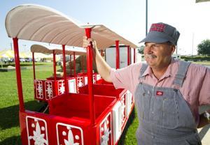 Cowboy Ken entertains fair-goers with train rides