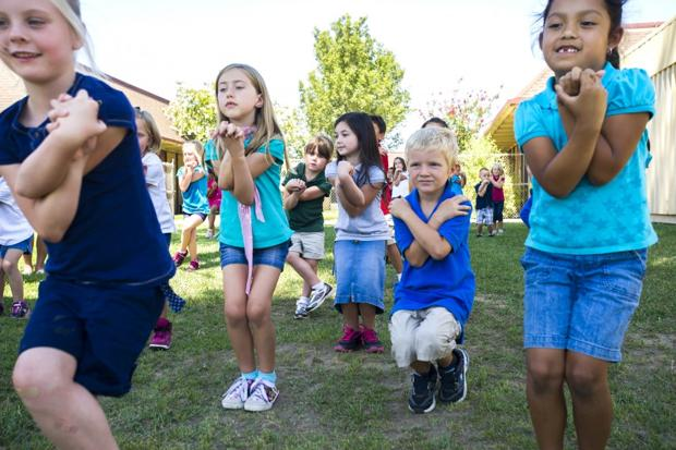 Vinewood Elementary School students give bikram yoga a try
