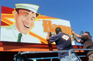 Lodi muralist creates 1950s-style signs for food concession building