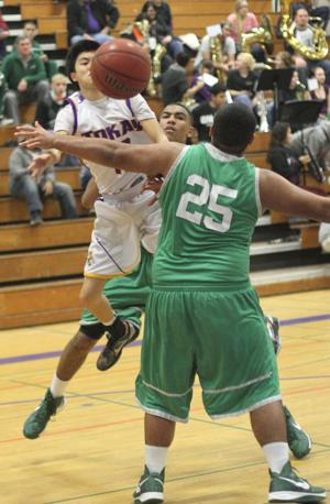 Boys basketball: Tigers hang tough for a half, but Rams pull away