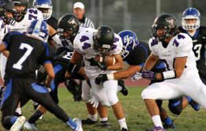 Football: After sluggish start, Tigers knock off Bruins in slugfest