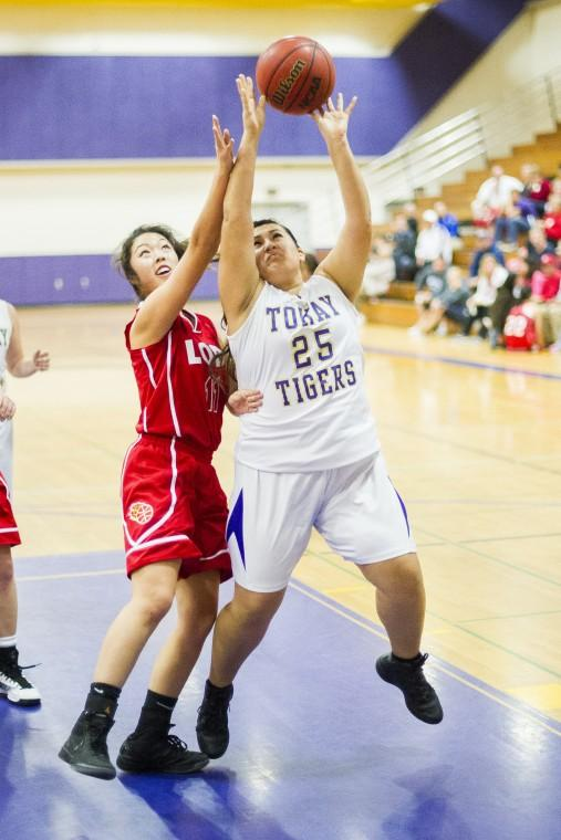 Tigers defeat rival Flames in preseason girls basketball opener