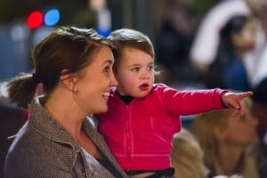 Parade Lights Up Lodi: Nicole Grauman, left, holds her daughter, Violet, as they watch the 17th annual Parade of Lights in Downtown Lodi on Thursday, Dec. 6, 2012.  - Dan Evans/News-Sentinel