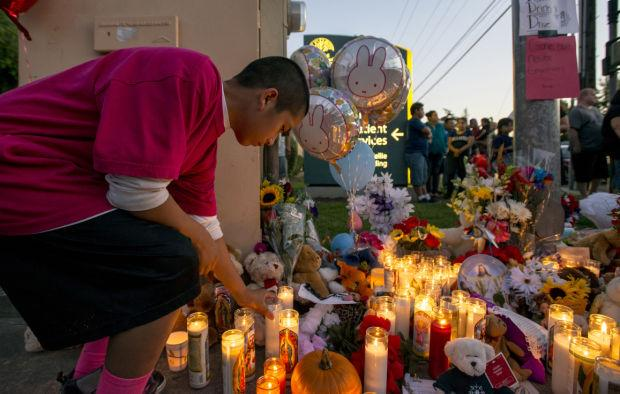 Friends, community gather at candlelight vigil to remember family who died