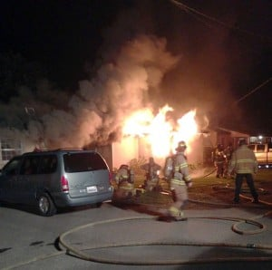 Residential Fire On Lower Sacramento Road: Lodi and Woodbridge fire departments respond to a structure fire on Lower Sacramento Road in Lodi on Saturday, Nov. 10, 2012.   - Photo by Jason Boak/courtesy Photograph