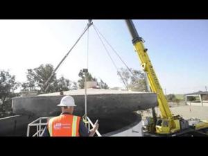 Crew removes lid from water treatment tank at White Slough