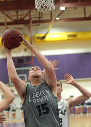 Boys Basketball: Hawks Outlast Falcons In Overtime, Advance To Section Championship : Nick Friend goes up and scores against a Colfax Falcons defender at Tokay High School on Wednesday, Feb. 27, 2013. The Hawks beat the Falcons 64-59 in overtime to advance to the Sac-Joaquin Section Division IV championship against the Summerville Bears of Tuolumne at Sleep Train Arena in Sacramento on Saturday, March 2, 2013.
