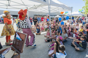 Little Buckaroos Saddle Up To Read At The Reading Roundup : Children show their excitement while Ravioli and Sparkles the clowns put on a magic show during the second annual Little Buckaroos Reading Roundup Literacy Fair, hosted by the Lodi News-Sentinel and the Lodi Public Library, on Locust Street in Downtown Lodi on Saturday, Aug. 24, 2013. - Ian Jonsson/News-Sentinel