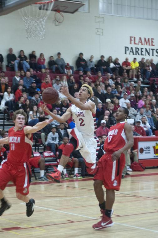 Boys basketball: Flames return to championship form with victory over Trojans