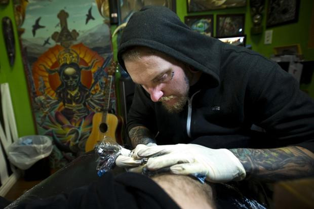 Local tattoo artist Josh Hughes inks his way to the top