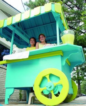 Children sell lemonade to help disadvantaged children