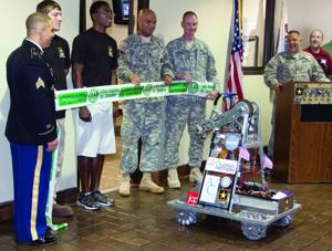 Lufkin High School Robotics team approaches to cut ribbon at the U.S. Army's Community Recruity Center in Lufkin Mall